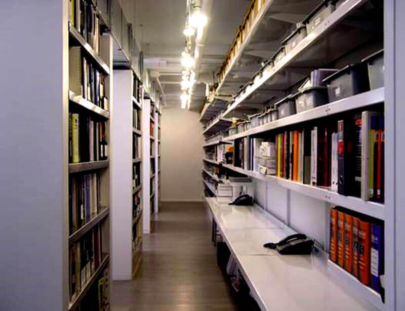 Media Storage Shelving with Integrated Work Surface by E-Z Shelving Systems, Inc.